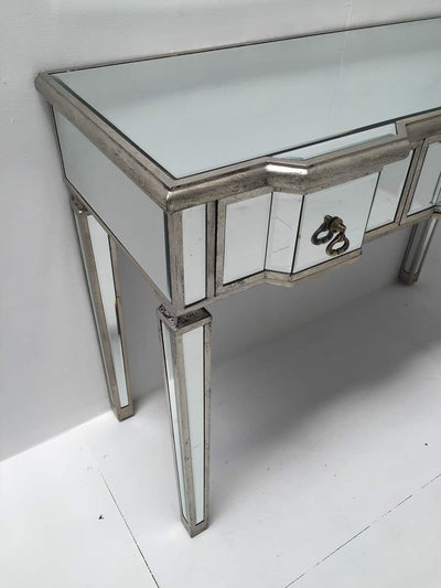 Charleston Mirrored Console Table with 3 drawers, vintage silver wood edging, glass top, tapered legs and drop ring drawer pulls