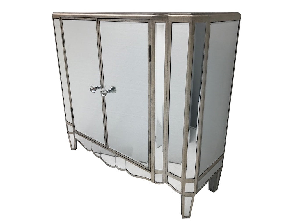 Very stylish vintage mirrored sideboard, with 2 doors, fitted with a shelf inside, all major panels are bevelled mirrors finished with an antiqued silver wood edge, wood and mirror, antiqued silver.