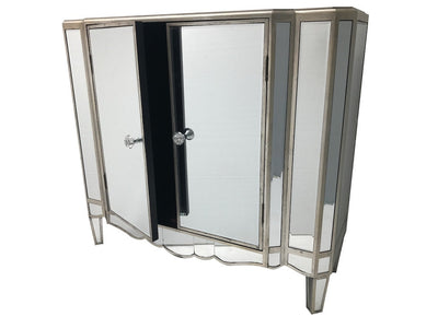Vintage mirrored sideboard, with two doors, fitted with a shelf inside, all major panels are bevelled mirrors finished with an antiqued silver wood edge, wood and mirror, antiqued silver.