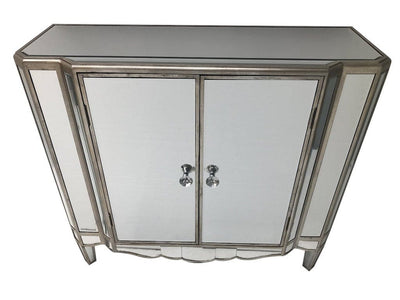 Hollywood mirrored sideboard, with two doors, fitted with a shelf inside, all major panels are bevelled mirrors finished with an antiqued silver wood edge, wood and mirror, antiqued silver.