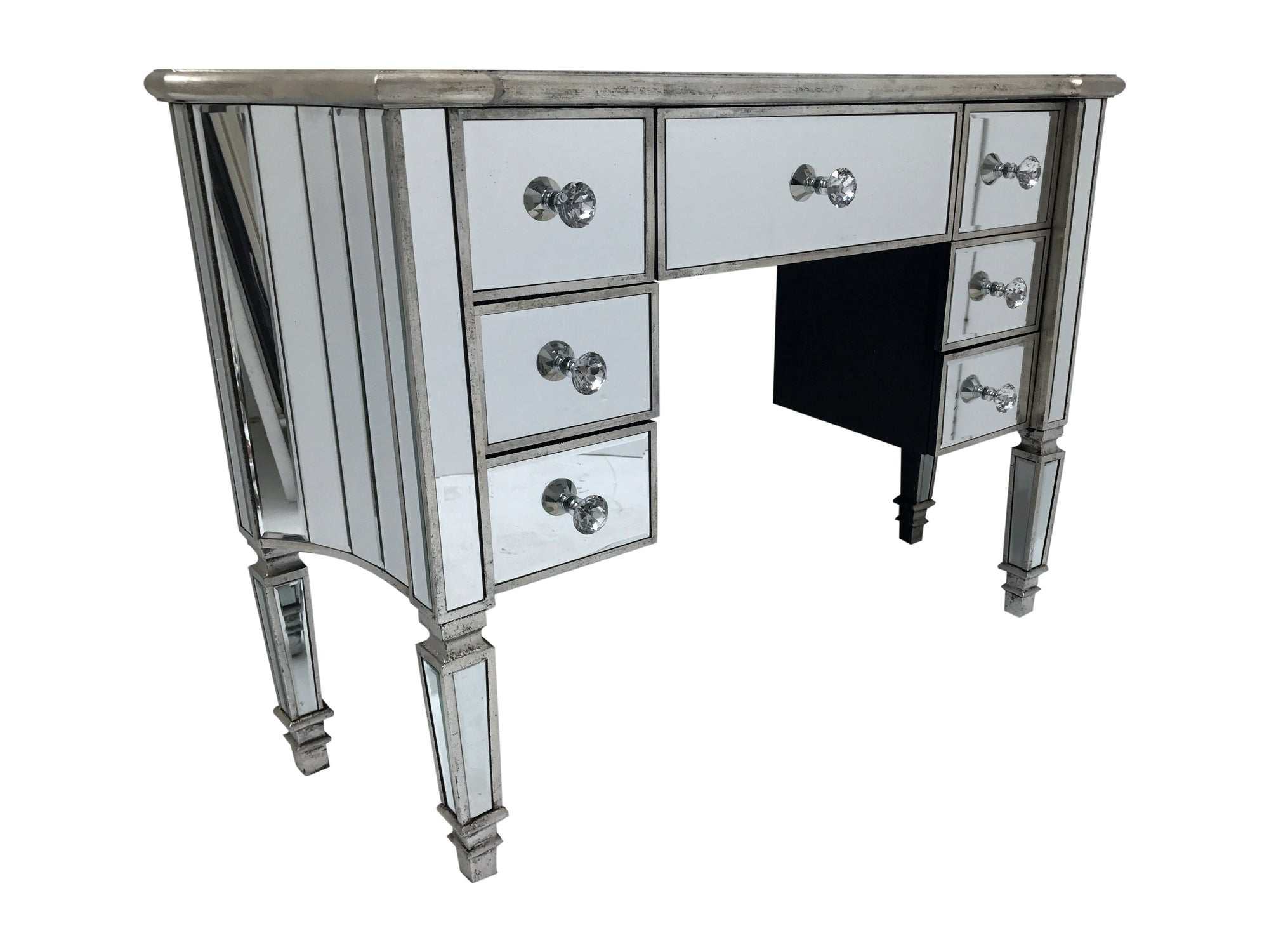 Kneehole mirrored dressing table, 7 drawers, crystal knobs, wood and mirror, antiqued silver.