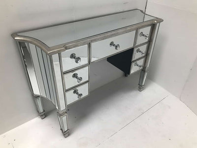 Mirrored dressing table, 7 drawers, crystal knobs, wood and mirror, antiqued silver.