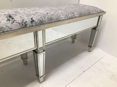 Charleston Mirrored extra long bench with all bevelled mirror panels, upholstered in a silver crushed velvet fabric, supported on 6 legs, wood and mirror and cloth, antiqued silver finish.