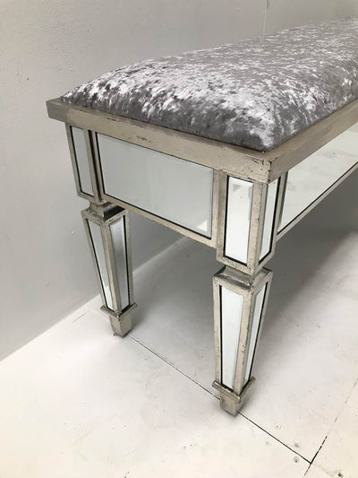 Mirrored Stool, extra long with all bevelled mirror panels, upholstered in a silver crushed velvet fabric, supported on 6 legs, wood and mirror and cloth, antiqued silver finish.