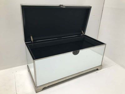 Hollywood Mirrored Trunk with all bevelled mirror panels, the lift up lid is upholstered in a silver crushed velvet material, so can be used as a seat when closed, wood and mirror and cloth, antiqued silver finish.