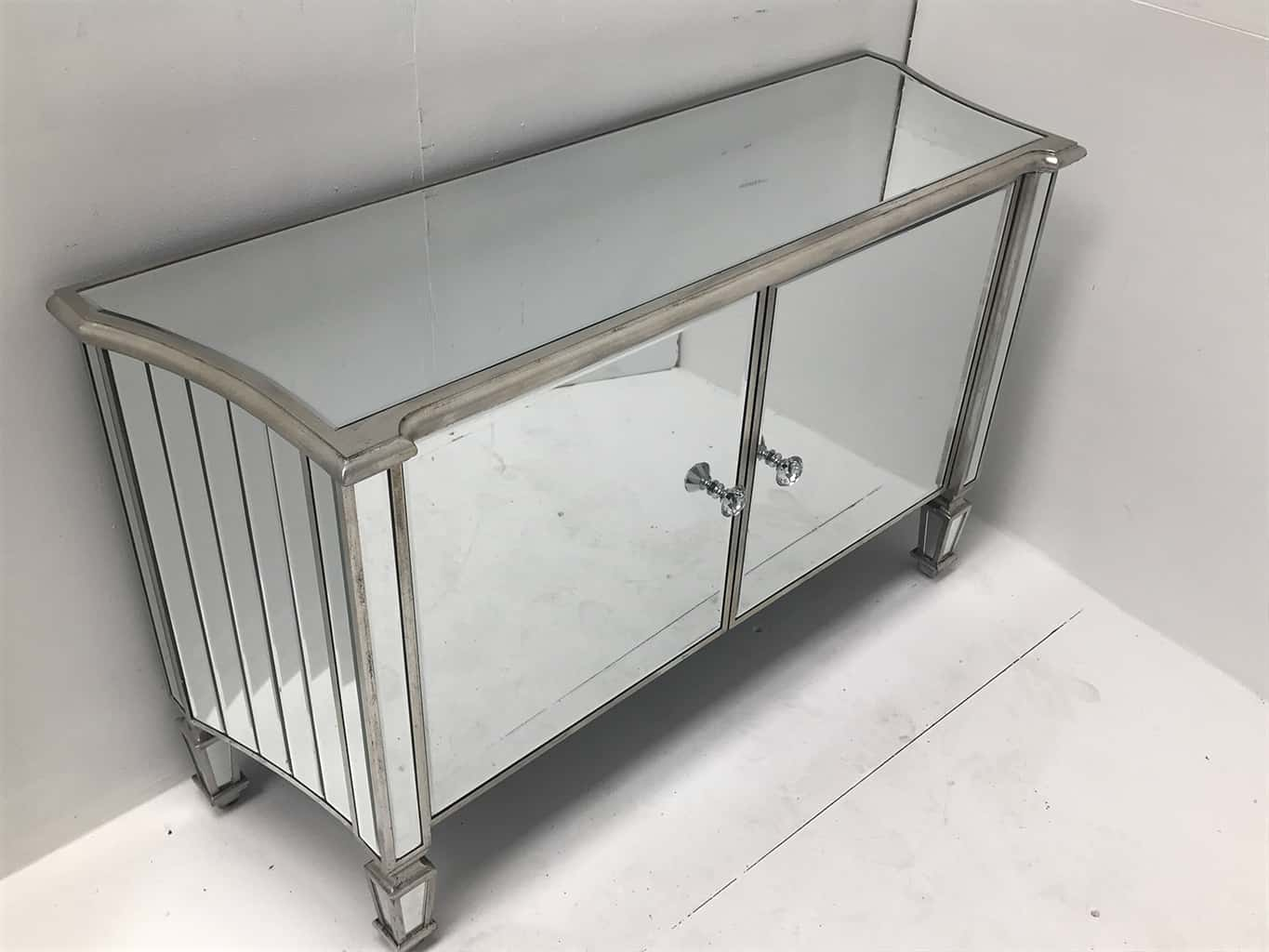 Marbella mirrored sideboard with 2 cupboard doors. All mirrored panels are bevelled and the ends are curved, crystal knobs, wood and mirror, antiqued silver