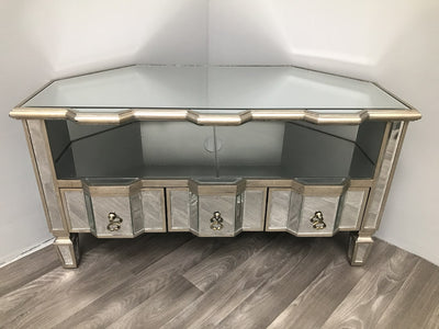 Mirrored corner table for tv with three drawers and a shelf