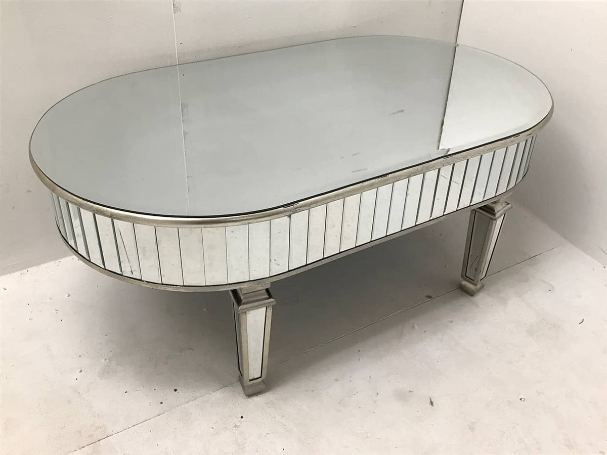 Round mirrored coffee table, bevelled mirror top and bevelled mirror panels to the sides and legs, antiqued silver wood edging