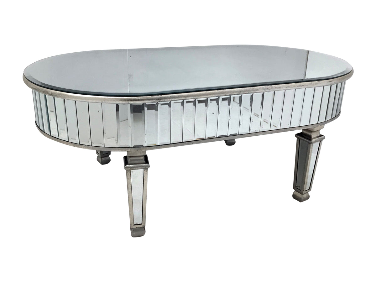 Oval ended mirrored coffee table with a border consisting of 3 1/2 cm wide bevelled mirror strips with bevelled mirror top and bevelled mirror panels to the legs, antiqued silver wood edging