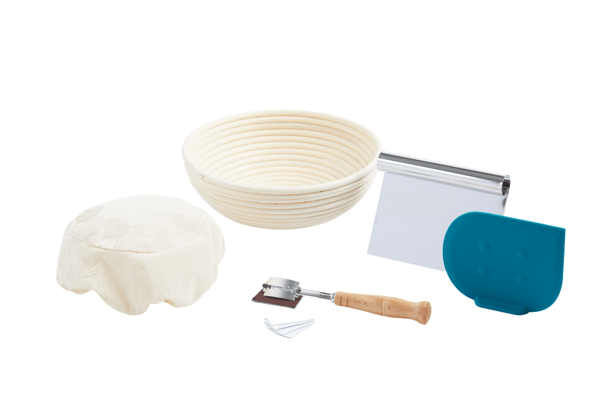 round banneton with liner, bread lame, bench scraper and dough scraper