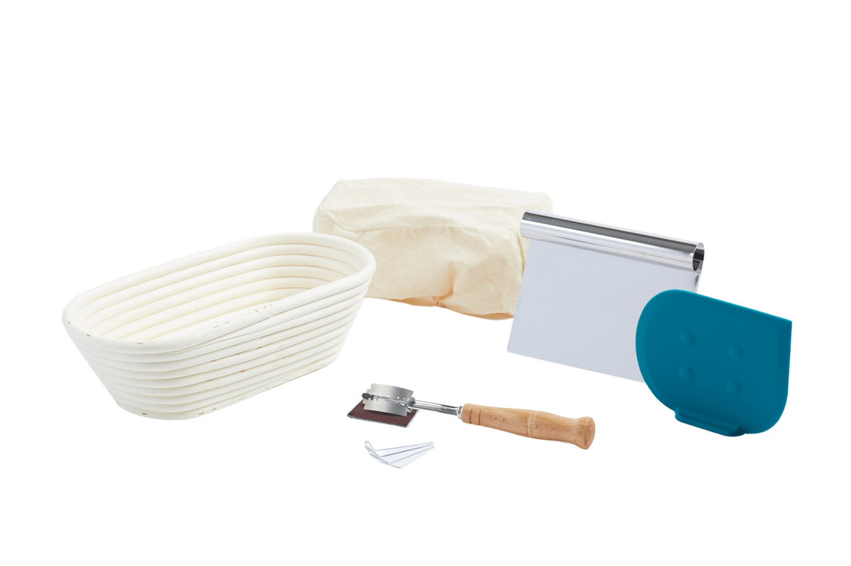 oval banneton with liner, bread lame, bench scraper and dough scraper