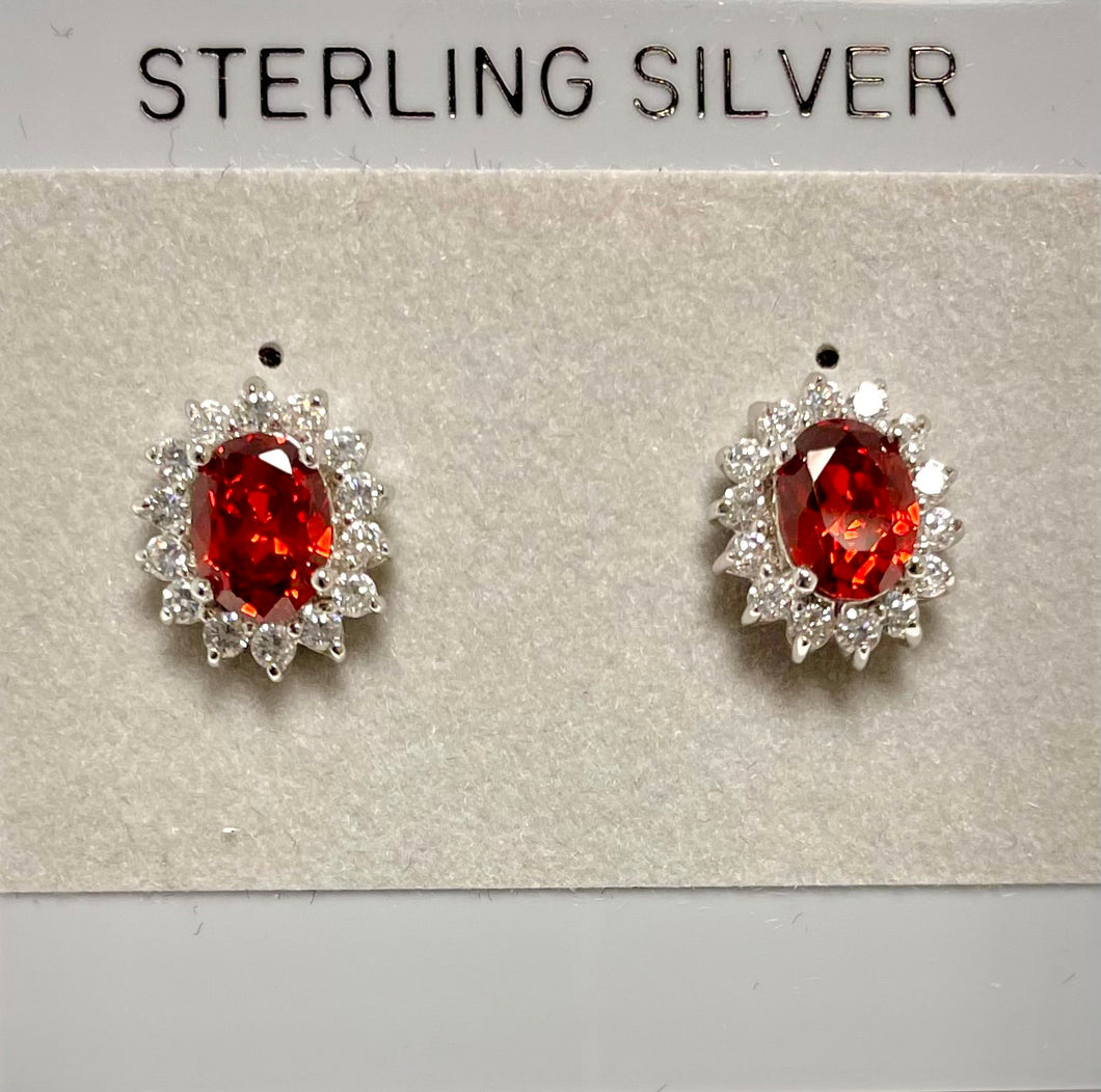 Sterling Silver Garnet and CZ Post Earrings.