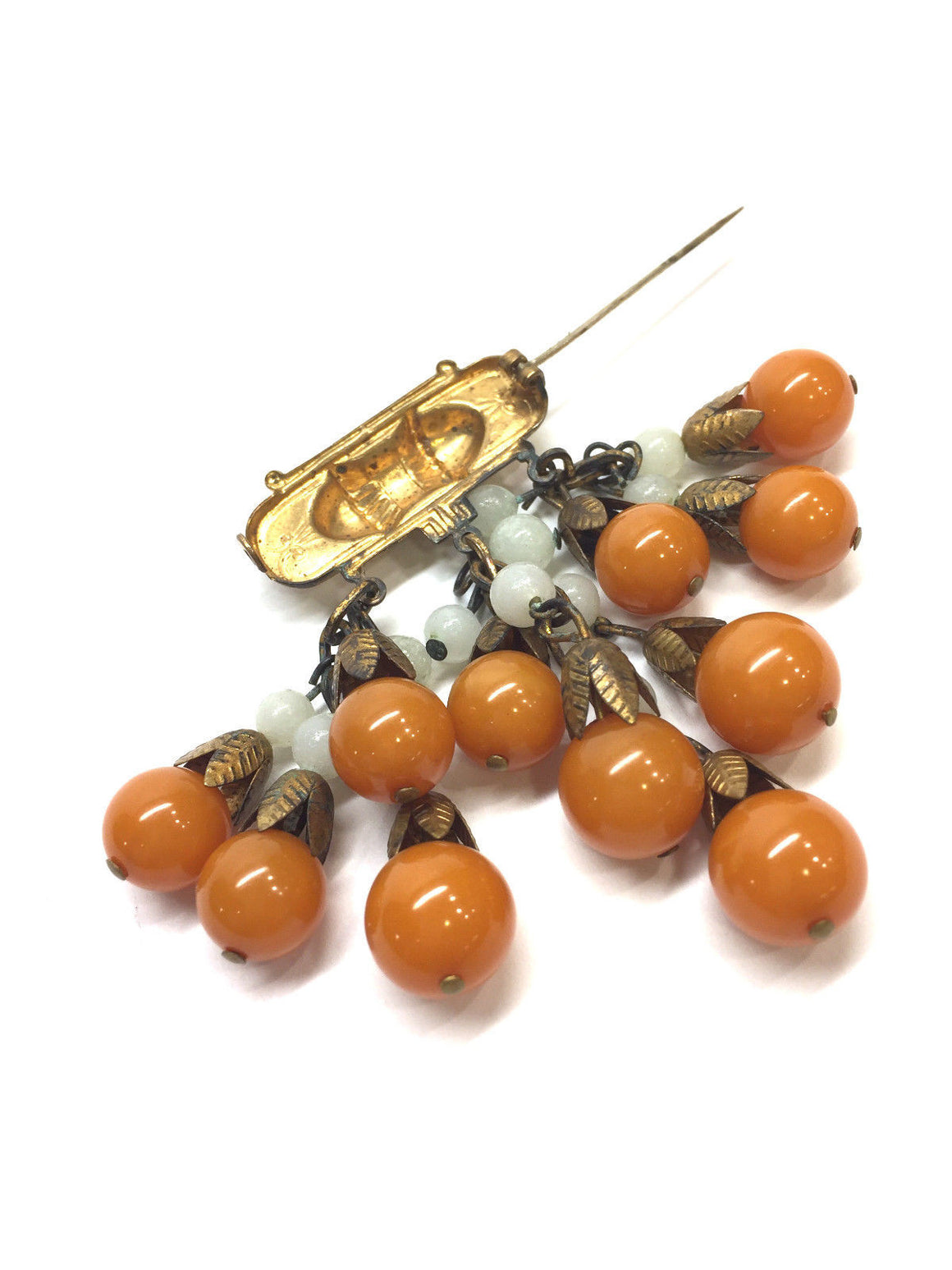 bisbiz.com VINTAGE Unbranded Bronze Bow Bar Cascading Amber Bakelite Beads Pin Brooch - Bis Luxury Resale