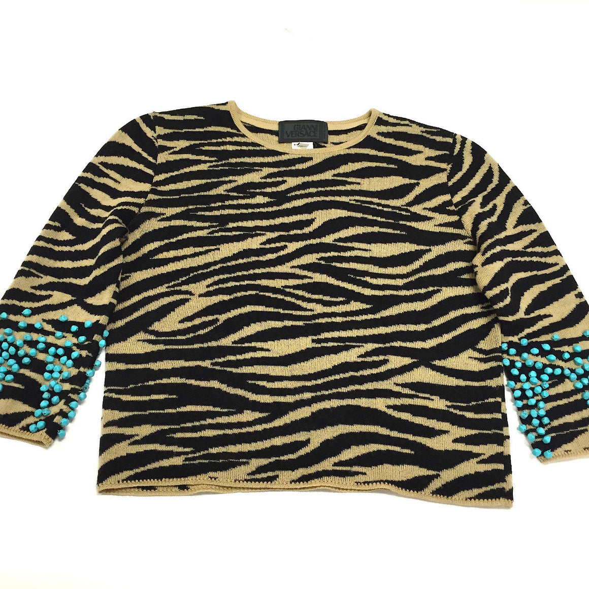 bisbiz.com GIANNI VERSACE  Beige/Black Zebra-Print Wool Sweater with Turquoise Beaded Sleeves  Size: IT40/6 - Bis Luxury Resale