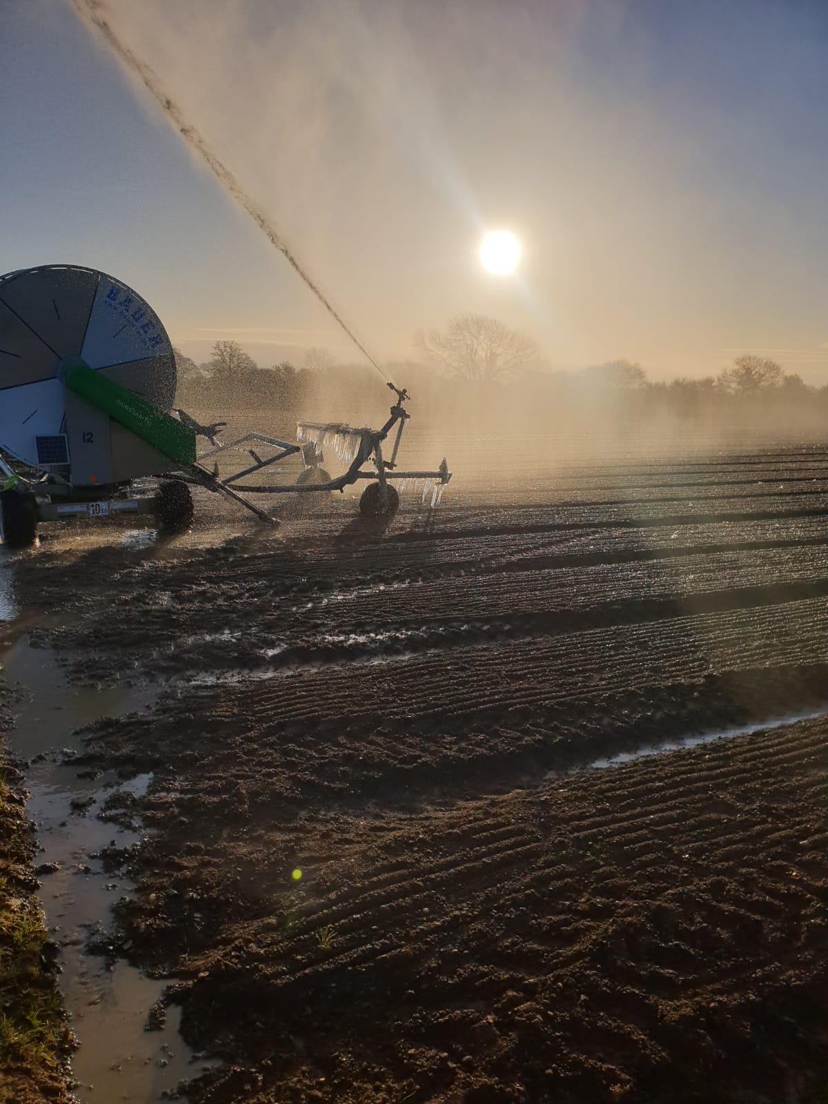 crop irrigator in an icy field