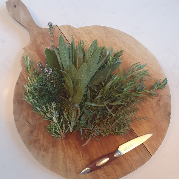 Board with mixed fresh herbs
