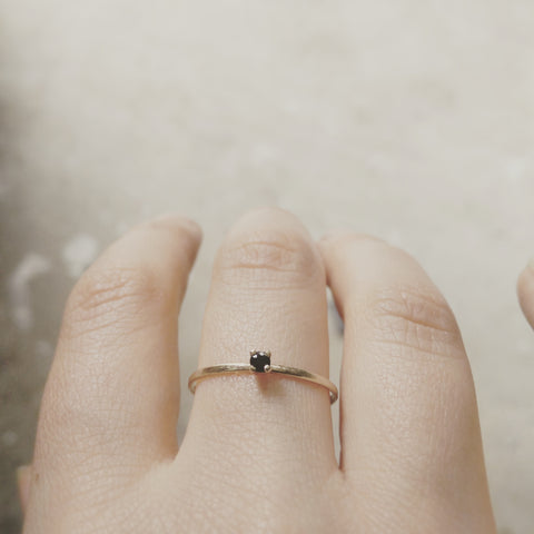 Delicate yellow gold and black sapphire ring