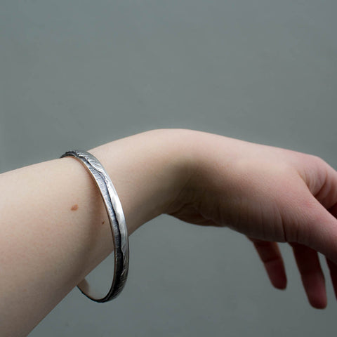 Remarkables mountain bangle in sterling silver.