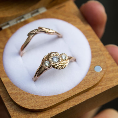 14ct rose gold twisted leaf engagement and wedding ring set.