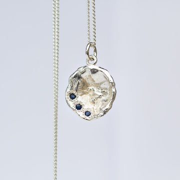 Water drop pendant with three sapphires