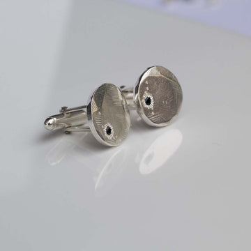 Round faceted cufflinks with black sapphire