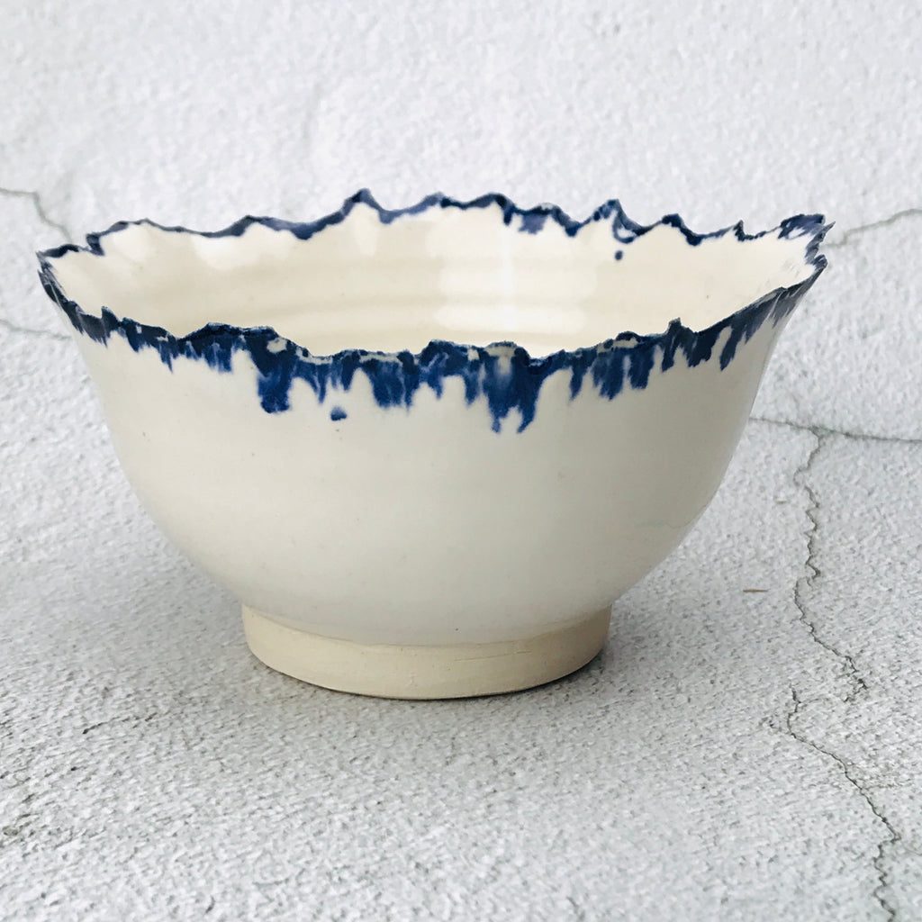 white bowl with uneven edge and blue highlights