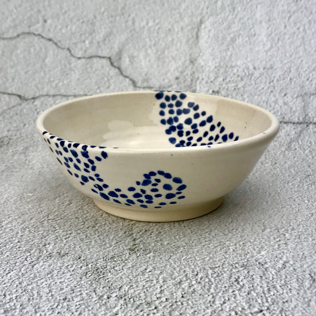 white bowl with blue dots in a swirling pattern