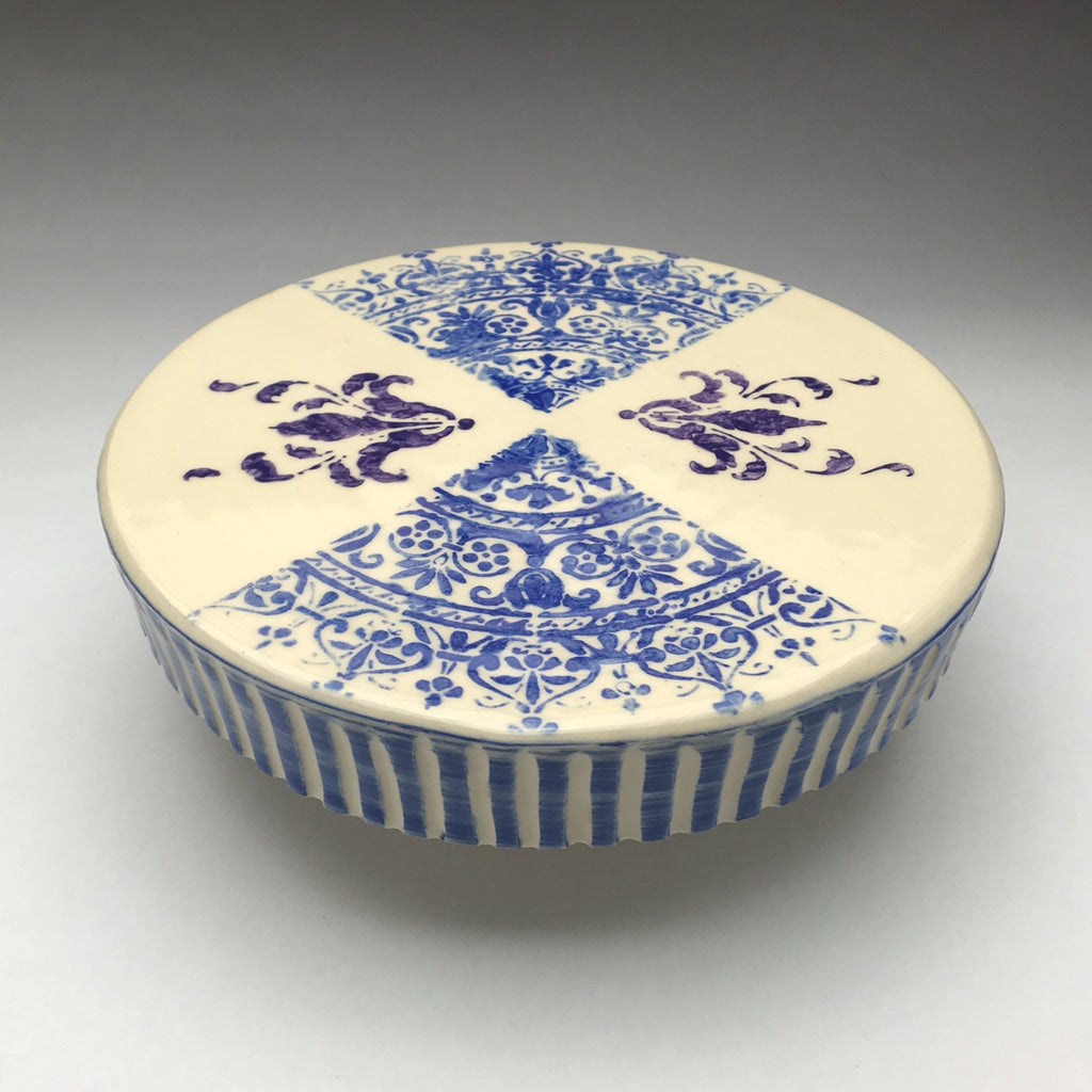 pottery cake stand with blue lace pattern,  purple flourishes and blue striped border