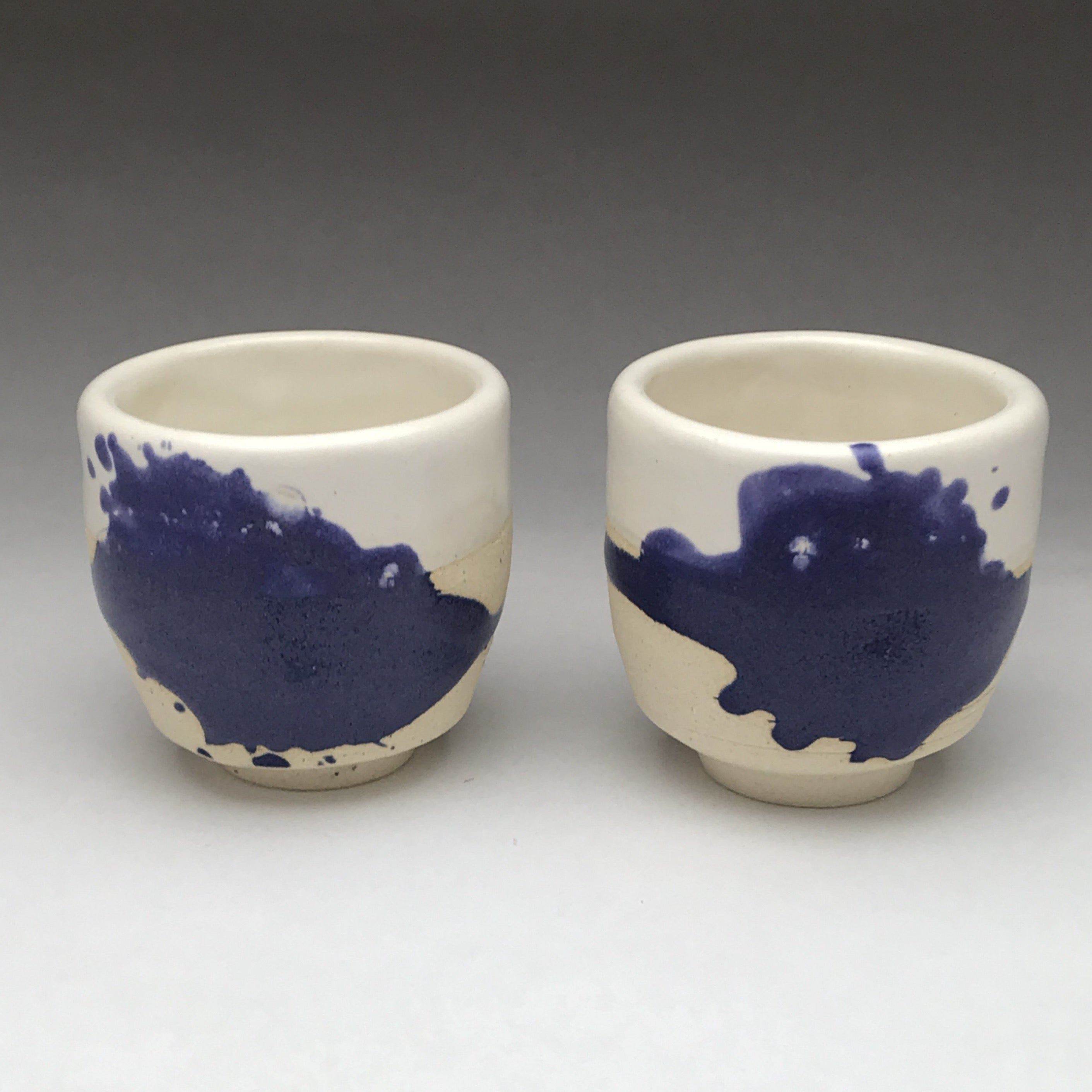 yunomi tea cup whiskey sipper with cobalt blue and white drippy design