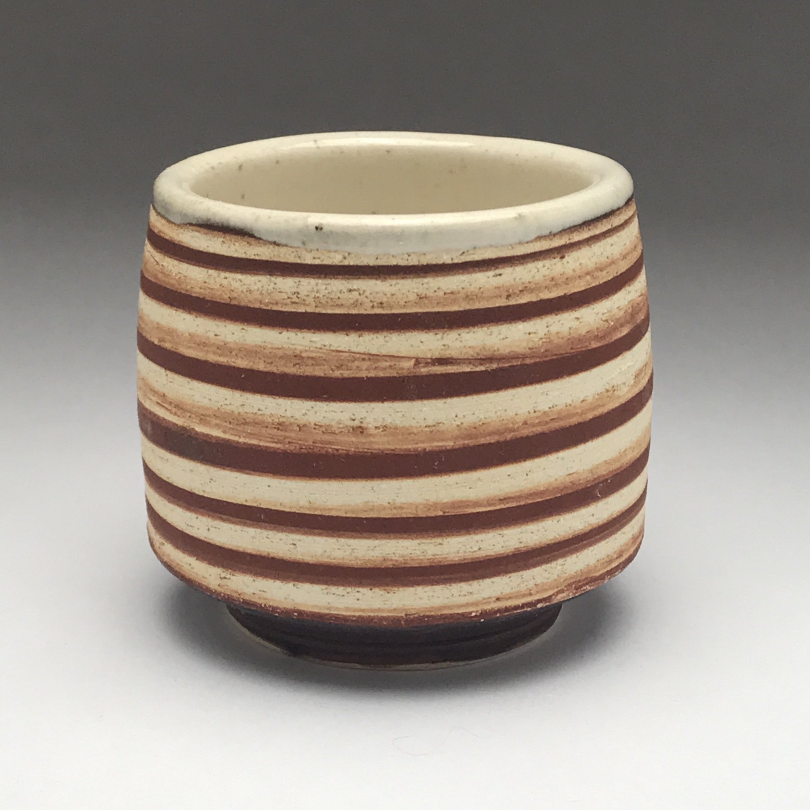 yunomi tea cup whiskey sipper with brown and white striped design
