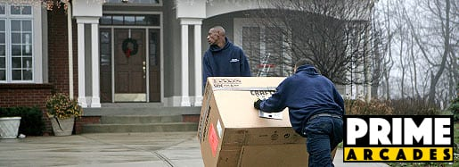 Guy Delivering Arcade to Home
