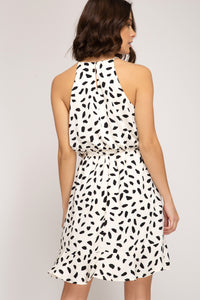 Printed Sleeveless Ivory Dress with Ruffled Hem and Sash