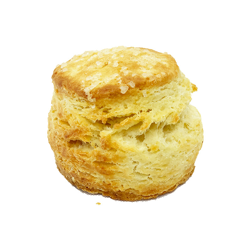 Side view of a plain looking scone topped with coarse sugar