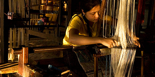woman weaving in laos