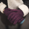 plum wool gloves worn by a model