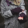 fingerless mittens in plum worn by a model