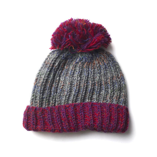 chunky knitted wool bobble hat with raspberry brim and pompom
