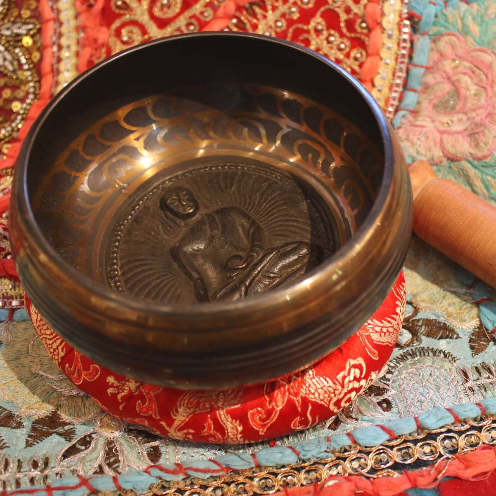buddha relief singing bowl from Nepal
