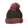 chunky knitted wool bobble hat with pink brim and pom pom