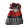 unisex bobble hat with striped pattern in red and blue