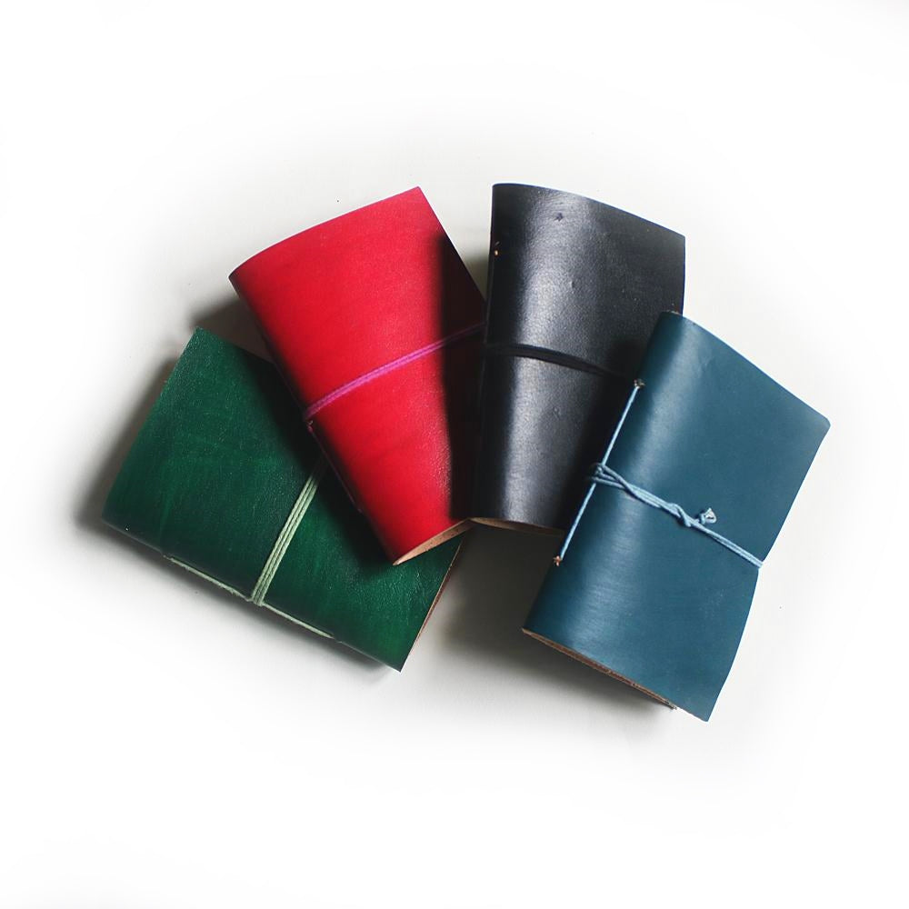 plain pocketbook leather journals in red, black, teal and green