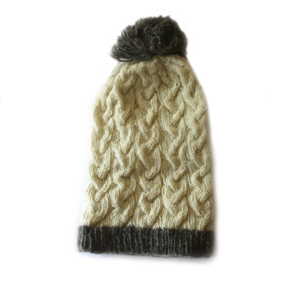 slouchy cable knit wool bobble hat in cream colours