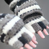 model wearing fingerless gloves with mitten flap in grey monochrome