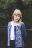 Rose wears block printed bolero style cotton jacket in indigo