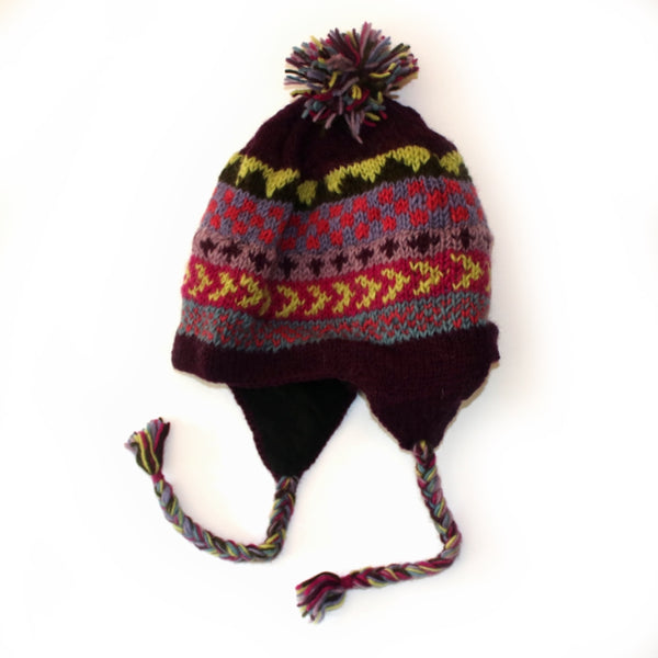 winter stripe bobble hat with purple pattern