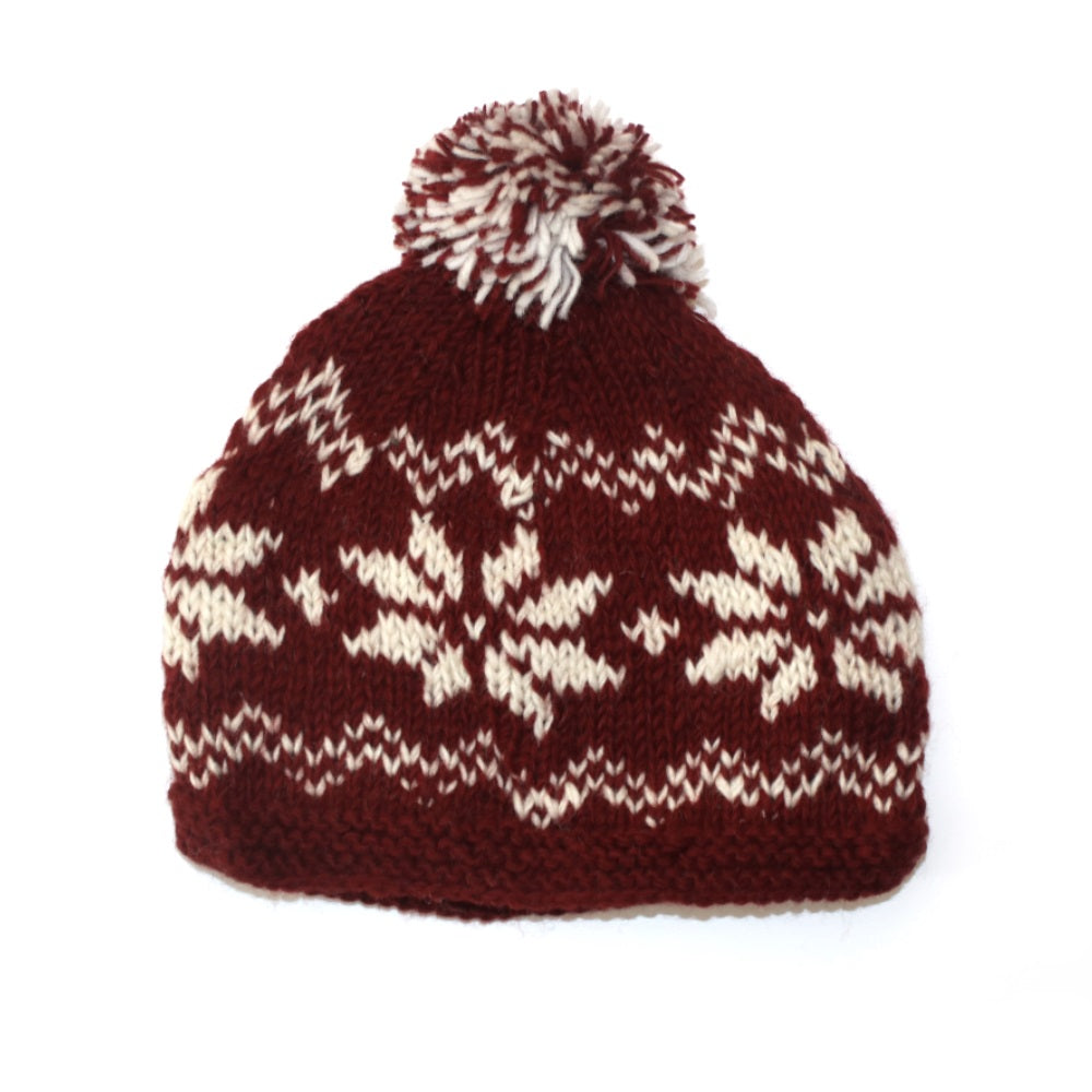 red bobble hat with nordic snowflake print d2fd283eb41