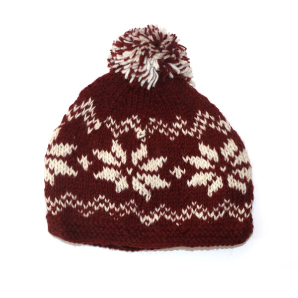 red bobble hat with nordic snowflake print