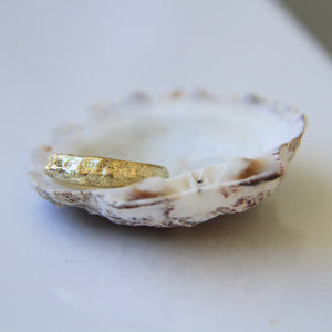 Narrowing raw gold ring