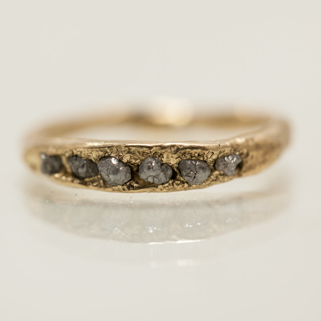 Rough concave ring with deep raw diamonds