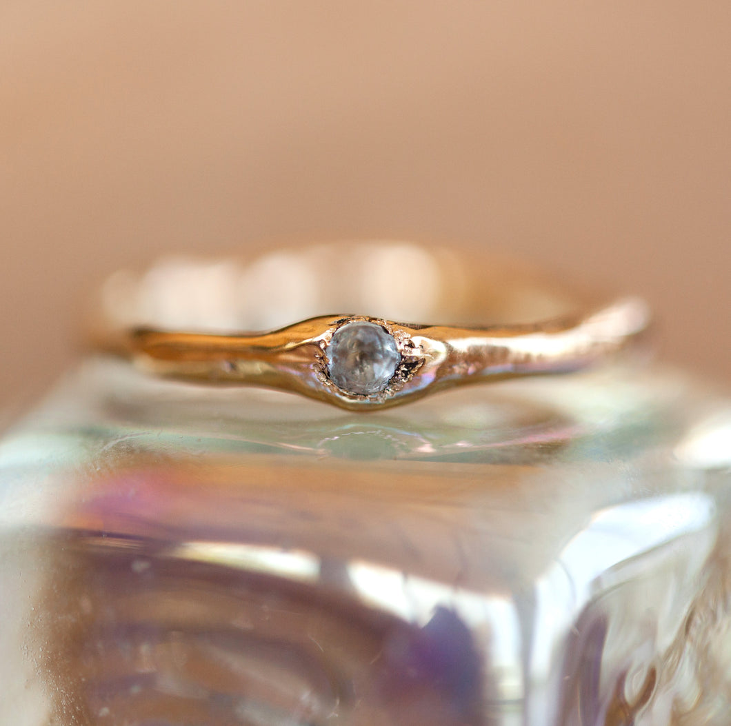 Raw gold ring with faceted aquamarine